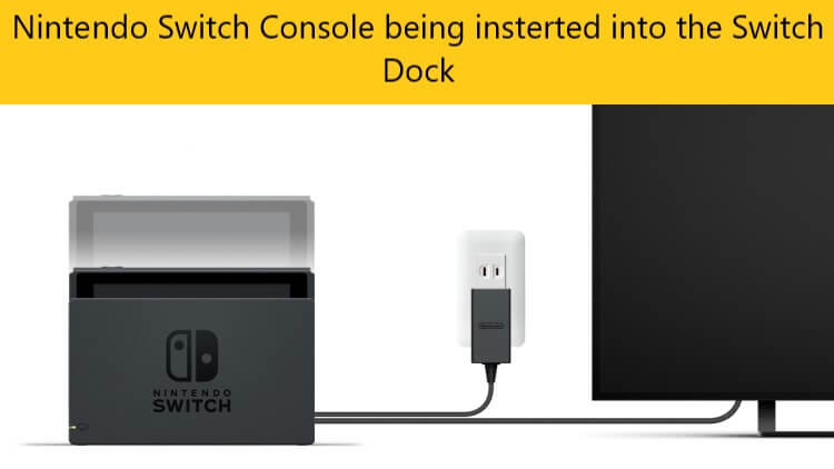 nintendo switch console being inserted into nintendo switch dock